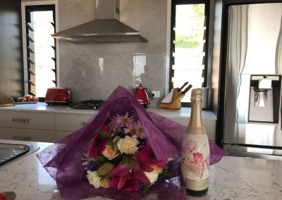 Cottonwood_Projects_kitchen_with_flowers_and_champagne